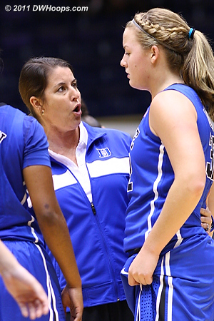 Coach P hops onto the floor during a break for a word with Liston  - Duke Tags: Joanne P. McCallie, #32 Tricia Liston