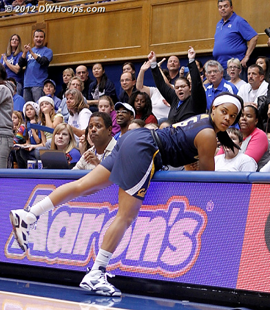 Climbing out of the stands with an eye back on the action  - CAL Players: #15 Brittany Boyd