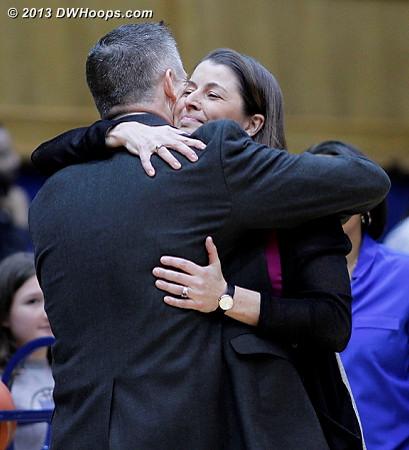 Duke coach Joanne P. McCallie and Boston College coach Erik Johnson embrace during pregame warmups