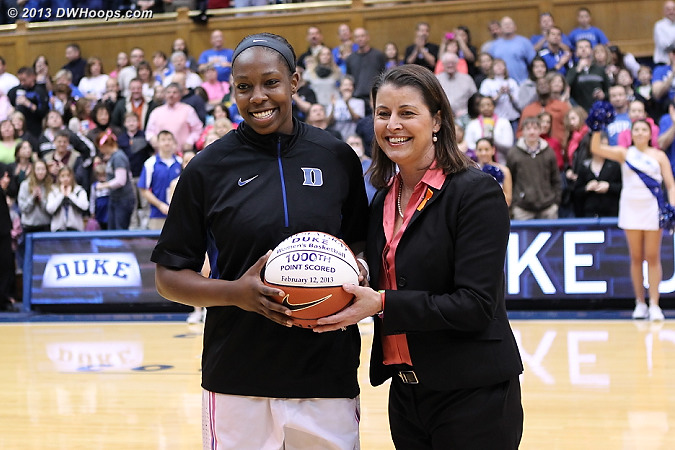 Chelsea Gray and Joanne P. McCallie pose at midcourt with a basketball awarded to Gray for scoring her 1000th career point at Duke.  Gray would later leave the game with a dislocated knee, putting the rest of her season in doubt.  - Duke Tags: #12 Chelsea Gray, Joanne P. McCallie