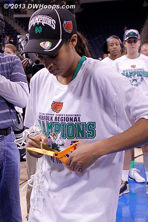 Cutting pieces of the net for the cheerleaders, a nice touch for Notre Dame's big star  - ND Players: #4 Skylar Diggins