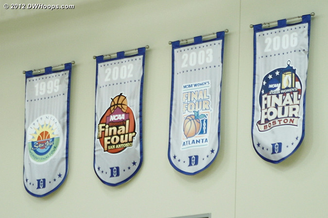 Final Four banners for both men's and women's basketball are prominently displayed in the K Center gym
