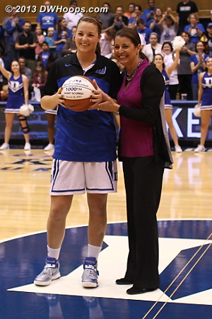 Tricia Liston awarded a basketball for surpassing the 1,000 point mark during the 2013 NCAA Tournament