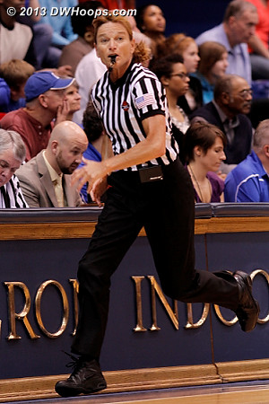 Dee Kantner rushes down court, one of an all-star officiating crew.