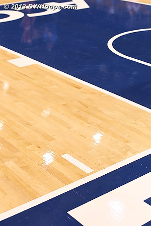 This new hashmark on the floor along with the second lane mark helps to define a restricted area rectangle.  If the ball is passed to a player inside this area the circle under the basket does not apply.  If a player dribbles into the area, then that rule is in play.