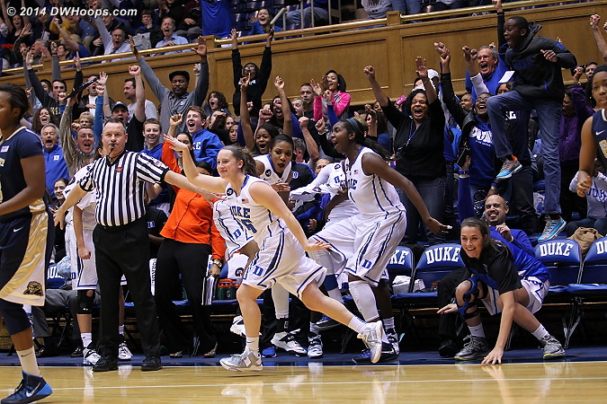 Duke's fans erupt after the Frush three pointer.  Her mother has apparently been swallowed up by the celebratory mob.