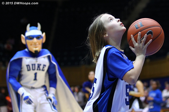 A young fan wins the NOSH shootout during a timeout - my bet is that she'll pick