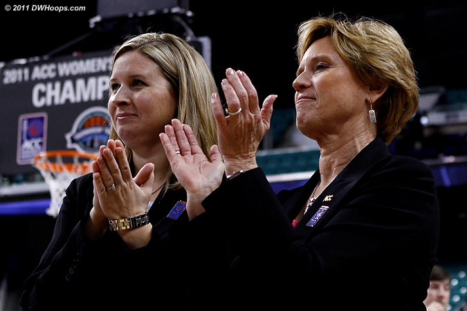 The ACC's Amy Yakola and Nora Lynn Finch applaud the champions.  We at DWHoops applaud them for yet another job well done with this tournament!