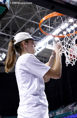 Alli cuts her piece of the net  - Duke Tags: #43 Allison Vernerey