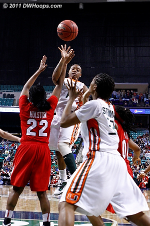 With the game tied at 64, Williams sees Stroman is open.  Her hoop would put Miami ahead for good.  - MIA Players: #32 Morgan Stroman, #1 Riquna Williams