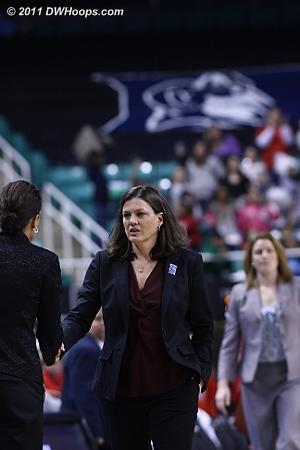 Coaches shake hands.