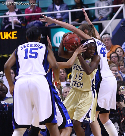 Marshall gets out of a triple team in the corner  - Duke Tags: #43 Allison Vernerey - GT Players: #15 Tyaunna Marshall