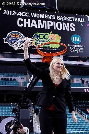 Maryland coach Brenda Frese displays the net after winning the 2012 ACC Championship  - MD Players: Head Coach Brenda Frese