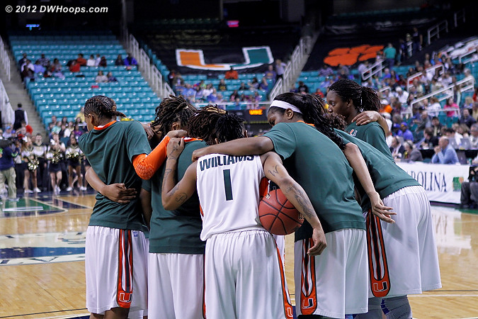 Miami huddle after an intense halftime warmup