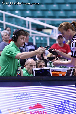 Lindy Brown, a man of many talents, was ready to give Dee Kantner the headphones for a video review of the play.  It was ruled a regular foul because contact was made with the forearm not the elbow.