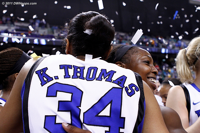 Krystal Thomas and Chelsea Gray embrace after Duke's 2011 ACC Championship victory.